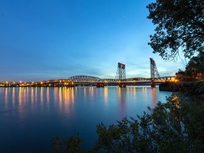 I5 Bridge over columbia river between Vancouver Washington and Portland Oregon at sunset.